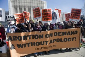 protesters with abortion on demand signs